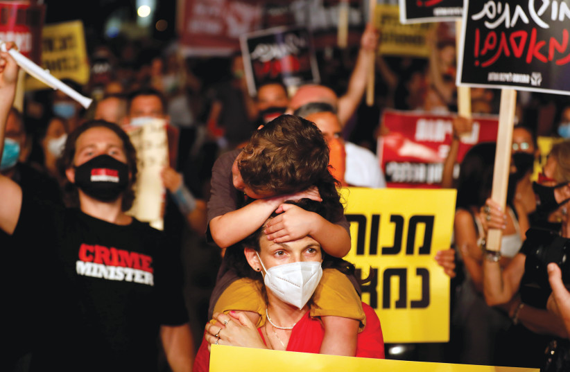 DEMONSTRATORS PROTEST the government's handling of the coronavirus pandemic, in Tel Aviv on July 18. (photo credit: AMIR COHEN/REUTERS)