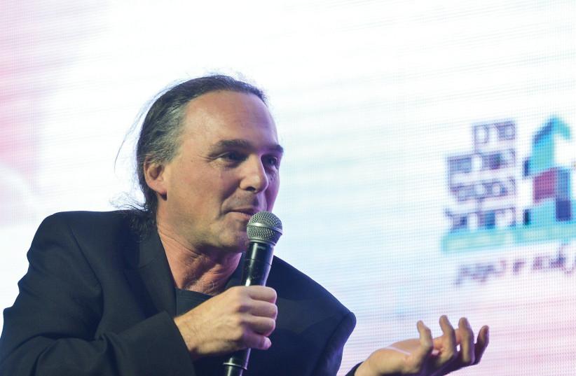 ISRAELI JOURNALIST Avishay Ben Haim speaks at 2019's international Municipal Innovation Conference in Tel Aviv. (photo credit: FLASH90)