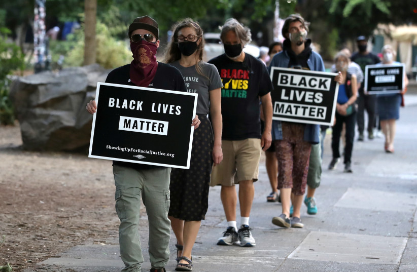 People participate in a meditation walk in support of Black Lives Matter organized by the Portland Buddhist Peace Fellowship near the Justice Center in Portland, Oregon, U.S., September 1, 2020. (photo credit: CAITLIN OCHS/REUTERS)