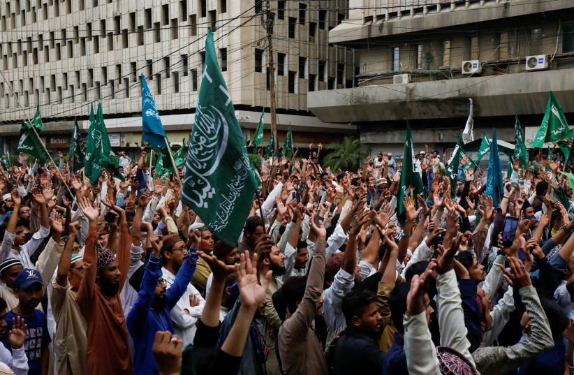 Supporters of religious and political party Tehreek-e-Labaik Pakistan (TLP) wave as they chant slogans against the satirical French weekly newspaper Charlie Hebdo, which reprinted a cartoon of the Prophet Mohammad, during a protest in Karachi, Pakistan September 4, 2020 (photo credit: REUTERS/AKHTAR SOOMRO)