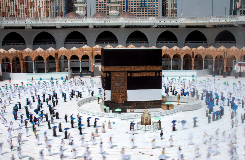 Muslim pilgrims maintain social distancing as they circle the Kaaba at the Grand mosque during the annual Haj pilgrimage amid the coronavirus disease (COVID-19) pandemic, in the holy city of Mecca, Saudi Arabia July 29, 2020 (photo credit: SAUDI MINISTRY OF MEDIA/HANDOUT VIA REUTERS)