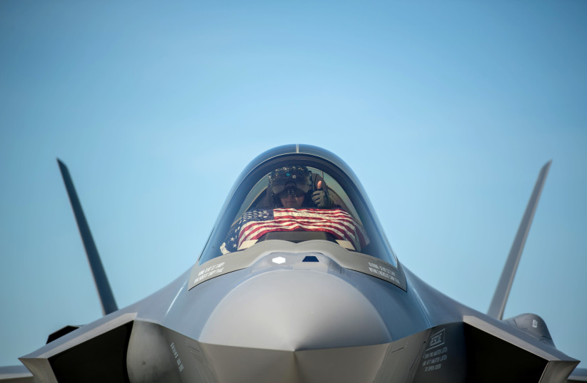 An F-35 pilot prepares for take off from the Vermont Air National Guard Base with the flag of the United States, May 22, 2020 (photo credit: US AIR NATIONAL GUARD/MISS JULIE M. SHEA/HANDOUT VIA REUTERS)