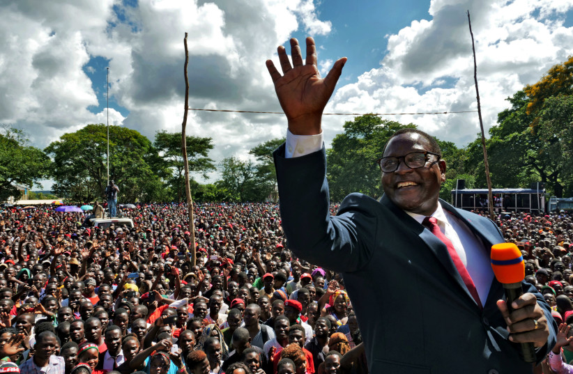 Opposition Malawi Congress Party leader Lazarus Chakwera addresses supporters after a court annulled the May 2019 presidential vote that declared Peter Mutharika a winner, in Lilongwe, Malawi, February 4, 2020 (photo credit: REUTERS/ELDSON CHAGARA)
