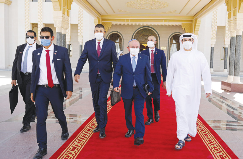 NATIONAL SECURITY ADVISER Meir Ben-Shabbat (fourth right) makes his way to board a plane to leave Abu Dhabi last week. (photo credit: REUTERS)