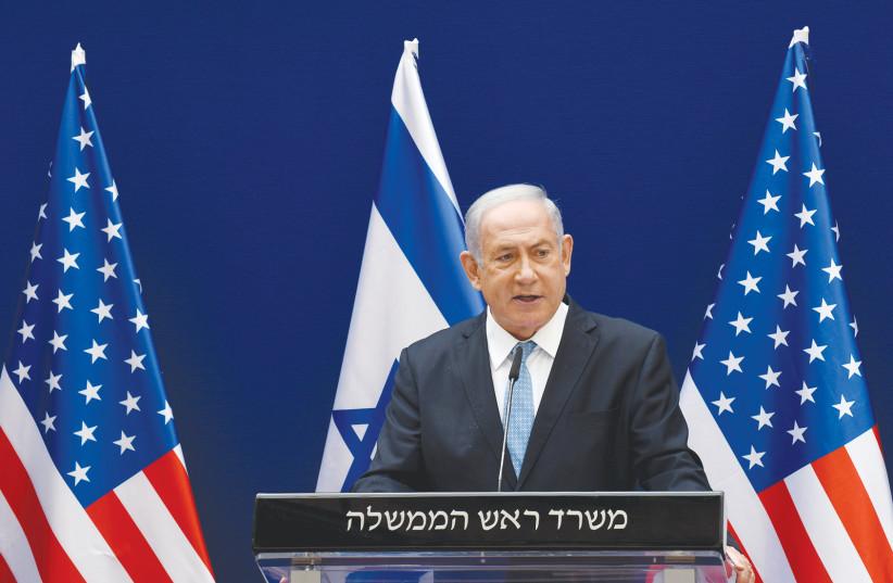 PRIME MINISTER Benjamin Netanyahu speaks about the Israel-UAE peace accords, in Jerusalem last month.  (photo credit: DEBBIE HILL/REUTERS)