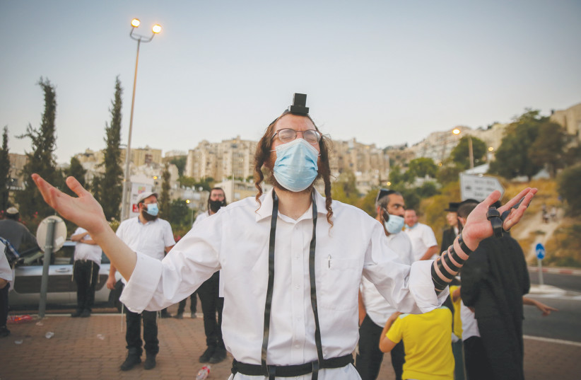 A BRESLOV HASSID in Safed joins a protest last week to demand a solution that will allow flights to Uman.  (photo credit: DAVID COHEN/FLASH 90)