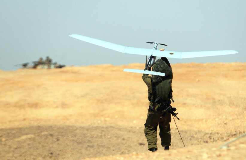 A SKYLARK drone is thrown by an IDF soldier during a military exercise in southern Israel in 2013 (photo credit: IDF SPOKESPERSON'S UNIT)