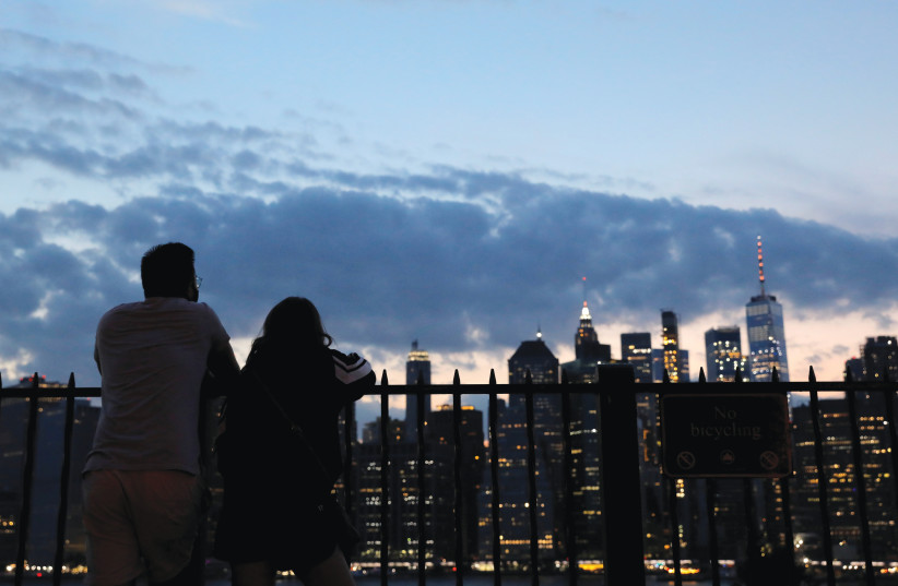 Gazing out at the altered skyline from a perch in Brooklyn, August 14 (photo credit: ANDREW KELLY / REUTERS)