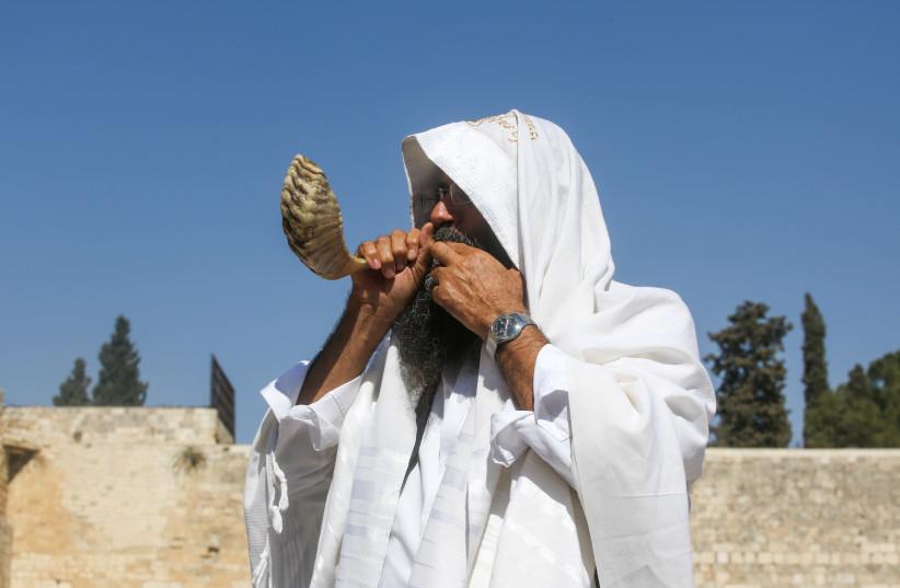 A man blowing the shofar at the Western Wall days before Rosh Hashanah (photo credit: MARC ISRAEL SELLEM)