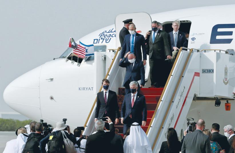 US SENIOR Presidential Advisor Jared Kushner, US National Security Advisor Robert O'Brien and Israeli National Security Advisor Meir Ben-Shabbat disembark at Abu Dhabi International Airport, UAE, August 31. (photo credit: REUTERS/CHRISTOPHER PIKE)