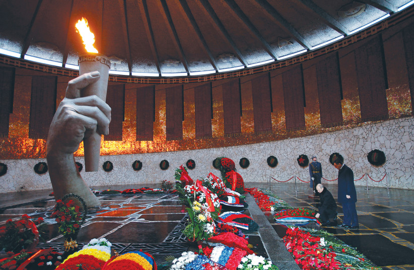 RUSSIA'S PRESIDENT Vladimir Putin takes part in a wreath laying ceremony at the Mamayev Kurgan World War II memorial complex in Volgograd dedicated to 'To the Heroes of the Battle of Stalingrad.' (photo credit: ALEXANDER ZEMLIANICHENKO/REUTERS)