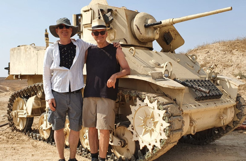 """Avi Nesher (right) and a crew member in frontof a 1948 tank that has been restored for the movie """"Portrait of Victory"""" (photo credit: Courtesy)"""