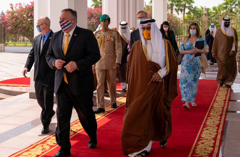 US Secretary of State Mike Pompeo walks with Bahrain Crown Prince Salman bin Hamad Al Khalifa during his visit to Manama, Bahrain, August 26, 2020. (photo credit: REUTERS)