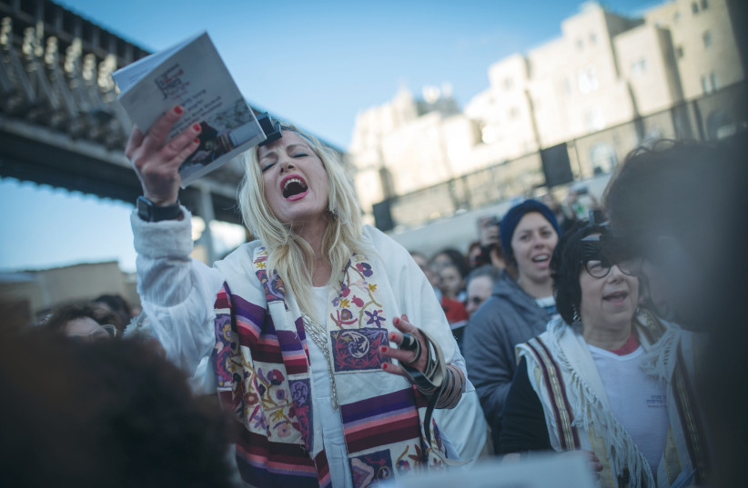 CALLING THEMSELVES 'Women of the Wall,' they turn up at the beginning of each Jewish month for morning prayers, not to pray quietly alongside other women, but to begin a loud communal service with their own leader chanting the prayers and disturbing the devotion in that relatively small area. (photo credit: HADAS PARUSH/FLASH90)