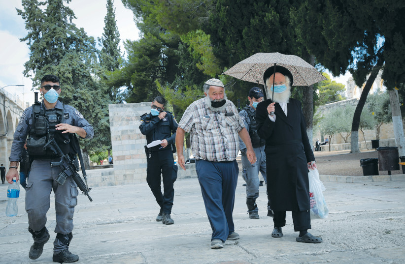 SECURITY FORCES escort a group of religious Jews during a visit to the Temple Mount last month. (photo credit: YOSSI ZAMIR/FLASH90)