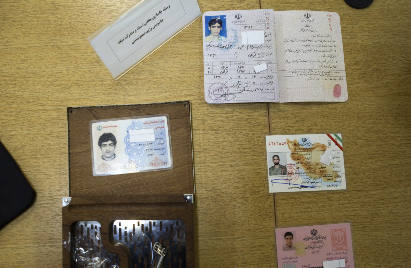 Iran's Intelligence Ministry display to the media what they said are fake identification cards which they confiscated as evidence after Iran's Intelligence Minister Heydar Moslehi's news conference in Tehran, January 11, 2011 (photo credit: REUTERS/MORTEZA NIKOUBAZL)