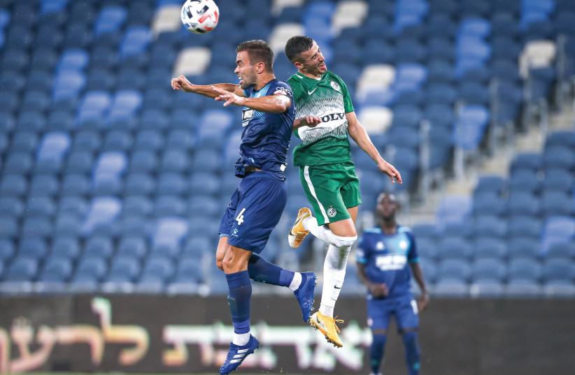 MACCABI HAIFA and Hapoel Beersheba (in blue) battled in front of empty stands at Sammy Ofer Stadium on Sunday night, with the Greens emerging with a 3-1 home victory in Israel Premier League Round 2 action. (photo credit: MAOR ELKASLASI)