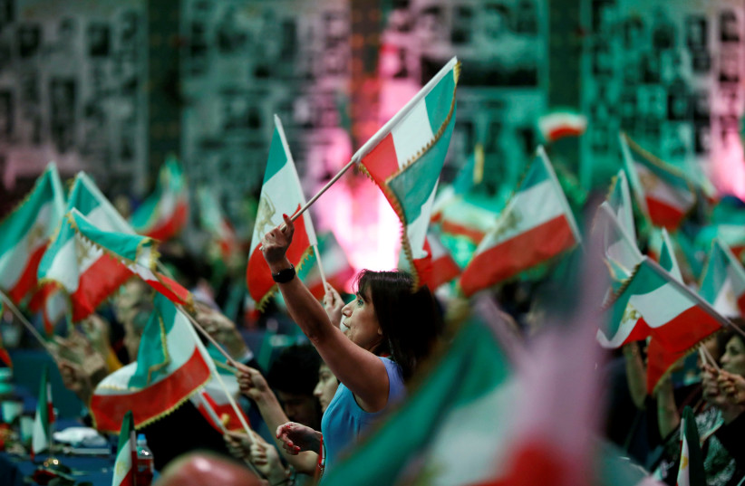 Attendees wave flags as Iranian Americans from across California converge in Los Angeles to participate in the California Convention for a Free Iran and to express support for nationwide protests in Iran from Los Angeles, California, U.S., January 11, 2020. (photo credit: REUTERS/ PATRICK T. FALLON)