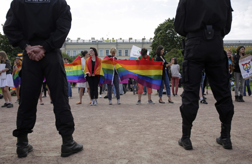 "Interior Ministry officers guard an LGBTQ+ community rally ""VIII St.Petersburg Pride"" in St. Petersburg, Russia August 12, 2017. (photo credit: ANTON VAGANOV/ REUTERS)"