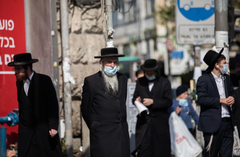 Haredi Jews prepare for the upcoming fesitval of Rosh Hashanah, Mea Shearim, Jerusalem, September 15, 2020 (photo credit: YONATAN SINDEL/FLASH90)
