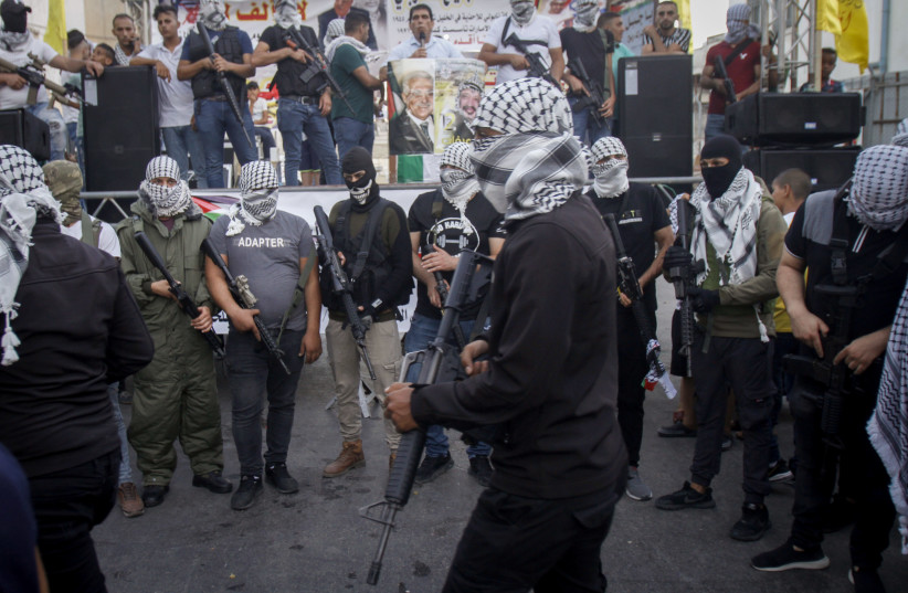 Palestinian militants of Fatah's al-Aqsa Martyrs Brigades take part in a military show as they protest against the deal between Israel and the UAE. August 22, 2020.  (photo credit: NASSER ISHTAYEH/FLASH90)
