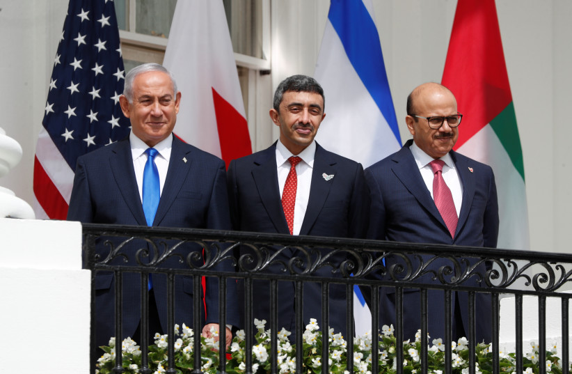 Israel's Prime Minister Benjamin Netanyahu, United Arab Emirates (UAE) Foreign Minister Abdullah bin Zayed and Bahrain's Foreign Minister Abdullatif Al Zayani standby prior to signing the Abraham Accords with US President Donald Trump at the White House in Washington, US, September 15, 2020. (photo credit: REUTERS/TOM BRENNER)