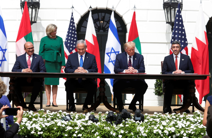L to R: Bahrain's Foreign Minister Abdullatif Al Zayani, Israel's Prime Minister Benjamin Netanyahu, US President Donald Trump and United Arab Emirates (UAE) Foreign Minister Abdullah bin Zayed participate in the signing ceremony of the Abraham Accords. September 15, 2020 (photo credit: REUTERS/TOM BRENNER)