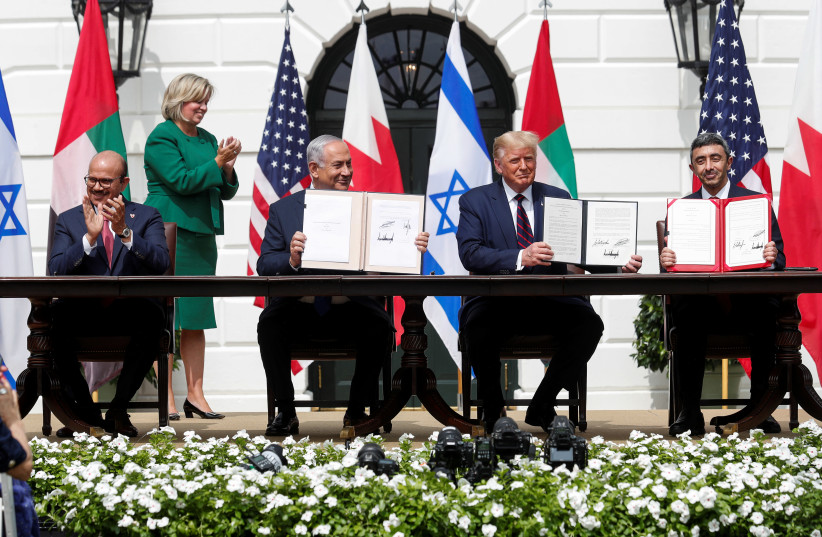 L to R: Bahrain's Foreign Minister Abdullatif Al Zayani, Israel's Prime Minister Benjamin Netanyahu, US President Donald Trump and United Arab Emirates (UAE) Foreign Minister Abdullah bin Zayed participate in the signing of the Abraham Accords. September 15, 2020 (photo credit: REUTERS/TOM BRENNER)
