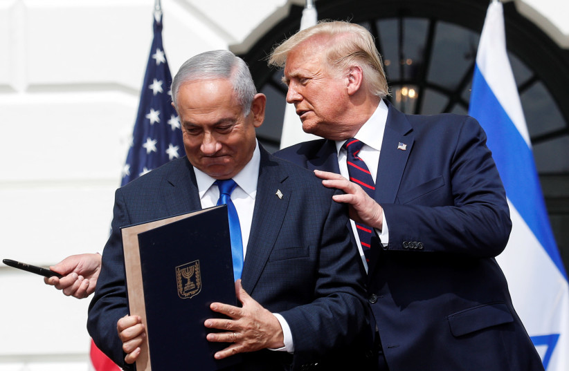 Israel's Prime Minister Benjamin Netanyahu stands with US President Donald Trump after signing the Abraham Accords. September 15, 2020. (photo credit: REUTERS/TOM BRENNER)