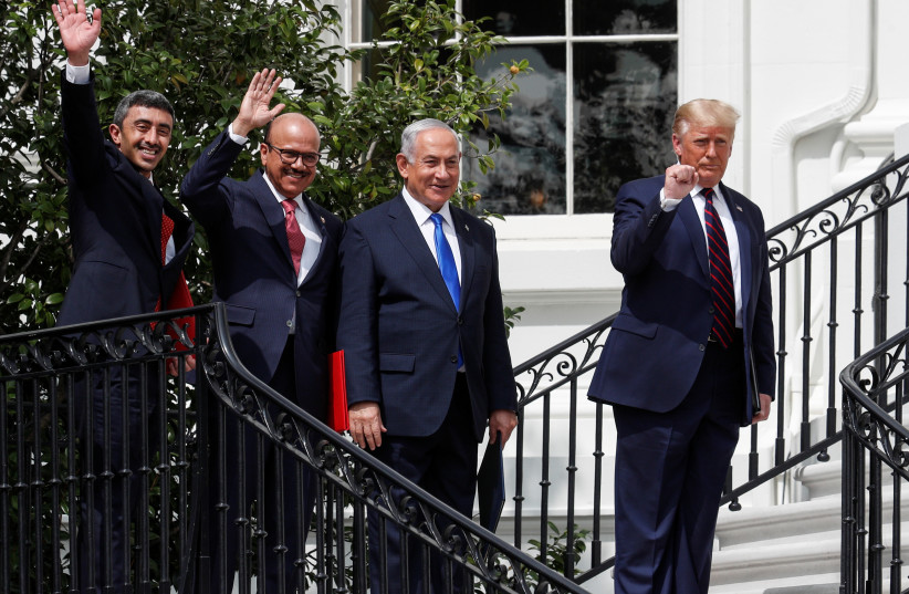 L to R: United Arab Emirates (UAE) Foreign Minister Abdullah bin Zayed, Bahrain's Foreign Minister Abdullatif Al Zayani, Israel's Prime Minister Benjamin Netanyahu and US President Donald Trump stand together after signing of the Abraham Accords. September 15, 2020. (photo credit: REUTERS/TOM BRENNER)
