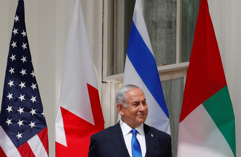 Israel's Prime Minister Benjamin Netanyahu istens prior to participating in the signing of the Abraham Accords at the White House in Washington, U.S., September 15, 2020 (photo credit: REUTERS//TOM BRENNER)