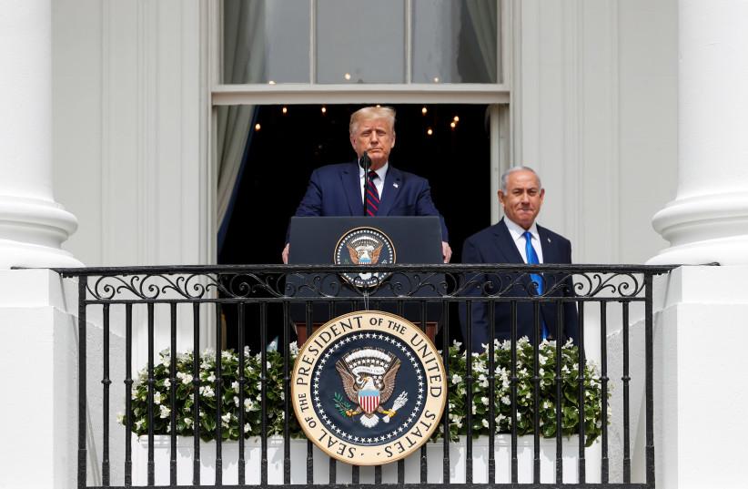 US President Donald Trump speaks next to PM Benjamin Netanyahu before signing Abraham Accords (photo credit: REUTERS/TOM BRENNER)