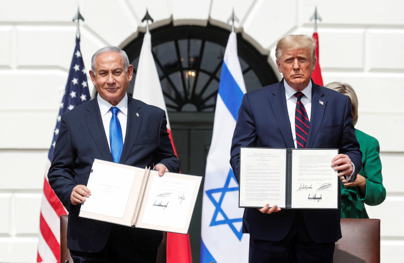 Israel's Prime Minister Benjamin Netanyahu stands with U.S. President Donald Trump after signing the Abraham Accords (photo credit: REUTERS/TOM BRENNER)