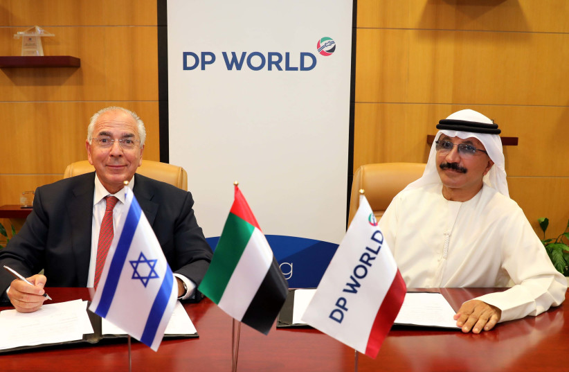 DoverTower owner Shlomi Fogel (L) signing a cooperation deal with DP World CEO Sultan Ahmed bin Sulayem.  (photo credit: Courtesy)