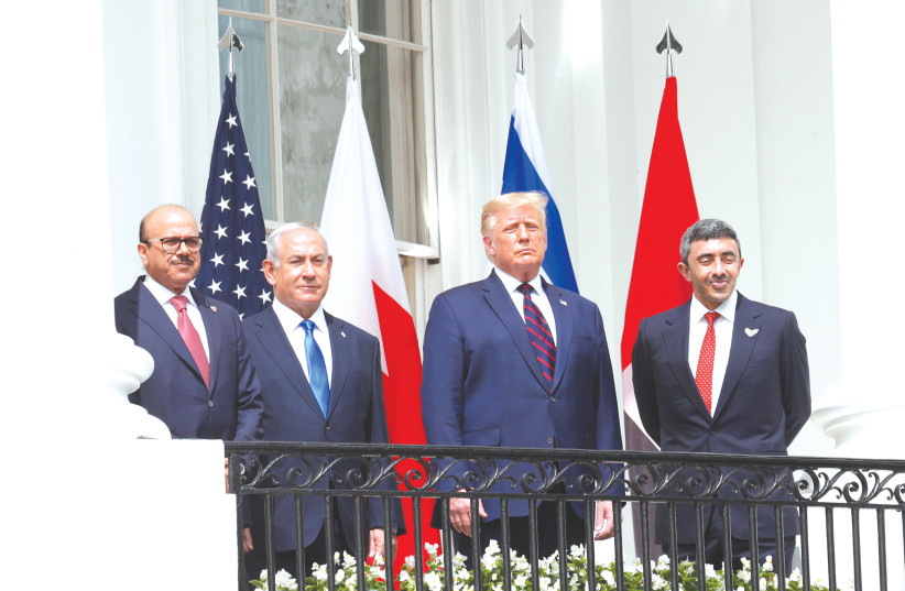 BAHRAIN'S FOREIGN MINISTER Abdullatif Al Zayani (left), Prime Minister Benjamin Netanyahu, US President Donald Trump and UAE Foreign Minister Abdullah bin Zayed gather on the balcony of the White House on Tuesday before the signing of the Abraham Accord.  (photo credit: TOM BRENNER/REUTERS)