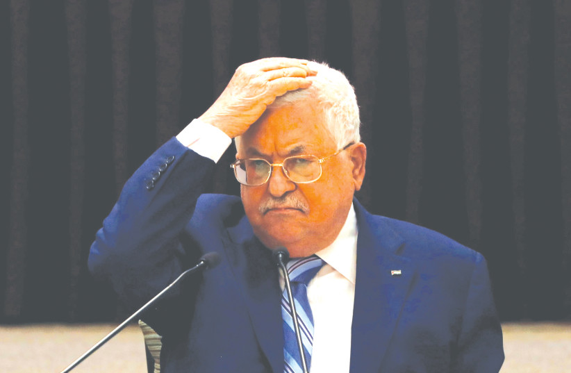 PALESTINIAN AUTHORITY President Mahmoud Abbas gestures during a meeting to discuss the UAE'S deal with Israel to normalize relations, in Ramallah last month. (photo credit: MOHAMAD TOROKMAN/REUTERS)