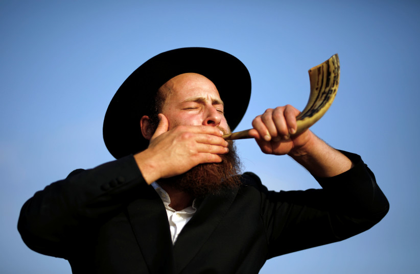 Why is the shofar blown during Elul? It forces the 'ba'al tekiah' to rehearse.  (photo credit: AMIR COHEN/REUTERS)