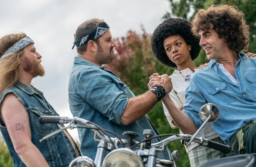 "Sasha Baron Cohen, right, as Abbie Hoffman in ""The Trial of the Chicago 7."" (photo credit: NIKO TAVERNISE/NETFLIX VIA JTA)"