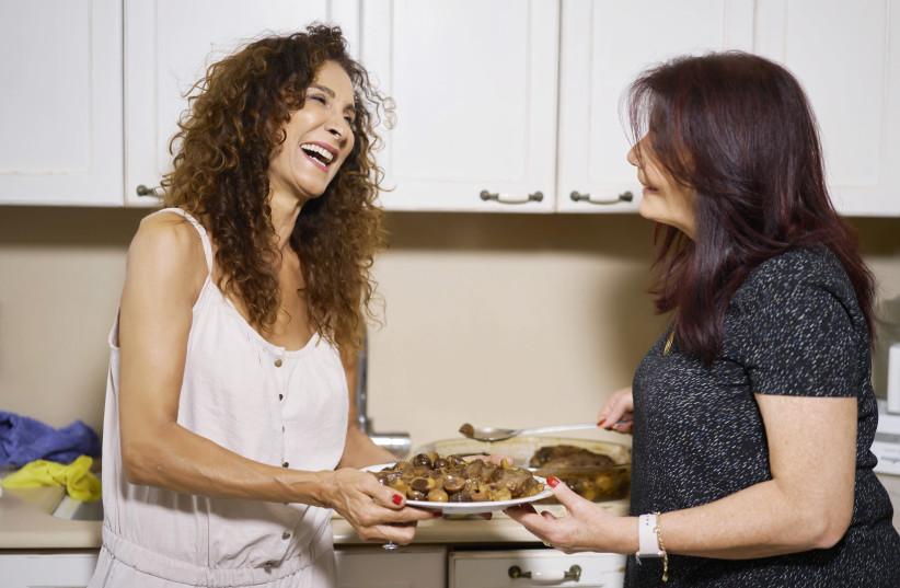 Pascale hosts singer Aviva Avidan in her kitchen.  (photo credit: RAMI ZARNEGAR)