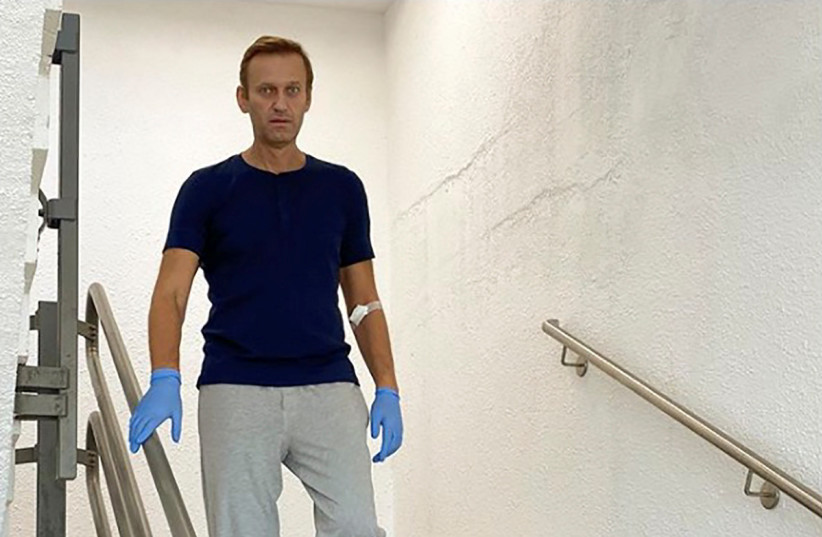 Russian opposition politician Alexei Navalny goes downstairs at Charite hospital in Berlin, Germany, in this undated image obtained from social media September 19, 2020 (photo credit: COURTESY OF INSTAGRAM @NAVALNY/SOCIAL MEDIA VIA REUTERS)