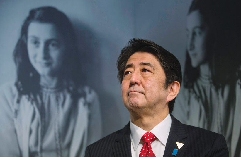 JAPAN'S FORMER prime minister Shinzo Abe visits the Anne Frank House museum in Amsterdam in 2014. (photo credit: REUTERS/CRIS TOALA OLIVARES)