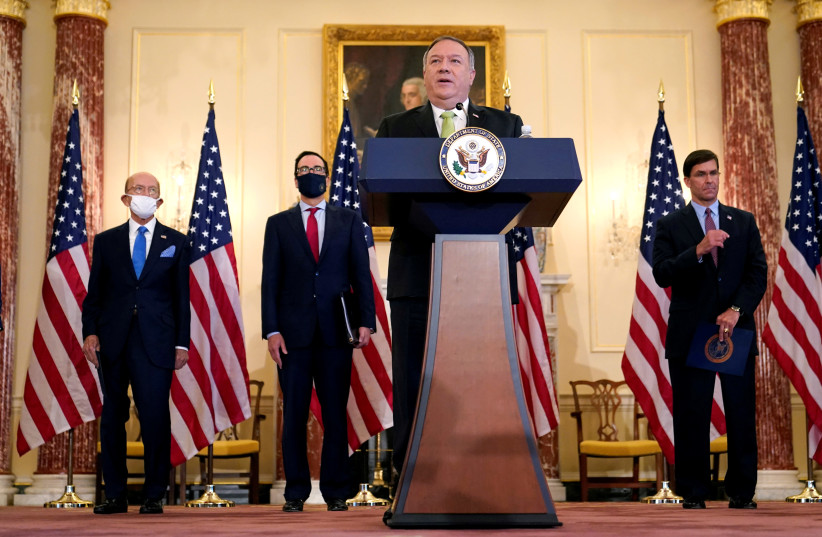 U.S. Secretary of State Mike Pompeo speaks next to Commerce Secretary Wilbur Ross, Treasury Secretary Steve Mnuchin, and Defense Secretary Mark Esper, during a news conference to announce the Trump administration's restoration of sanctions on Iran, at the U.S. State Department in Washington, U.S., S (photo credit: PATRICK SEMANSKY/POOL VIA REUTERS)
