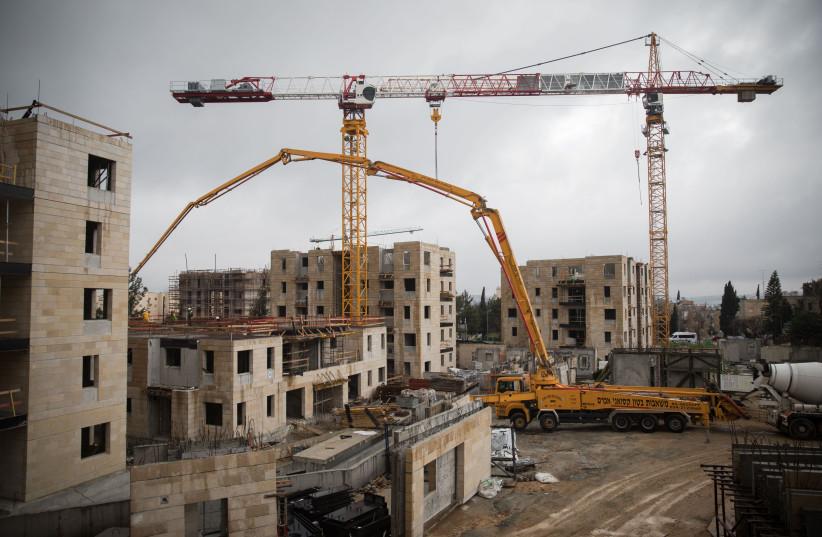 View of the construction site of 'Mechir Lamishtaken' at Armon Hanatziv neighborhood in Jerusalem on January 28, 2019. (photo credit: HADAS PARUSH/FLASH90)