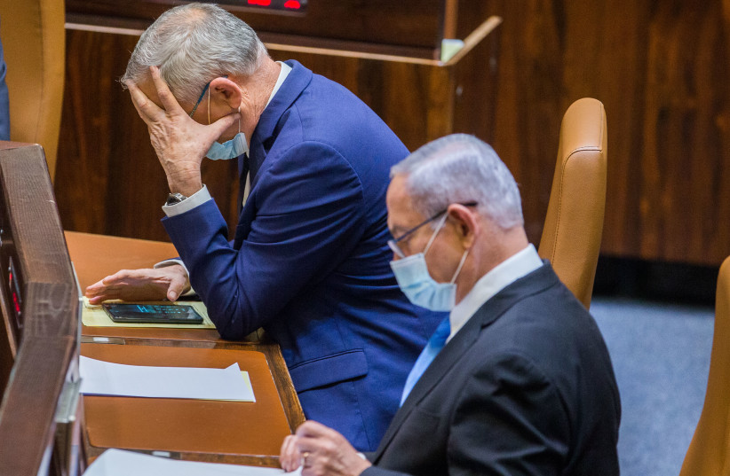 Alternate Prime Minister and Minister of Defense Benny Gantz and Israeli Prime Minister Benjamin Netanyahu seen during a vote at the Knesset, the Israeli parliament in Jerusalem on August 24, 2020. (photo credit: OREN BEN HAKOON/FLASH90)