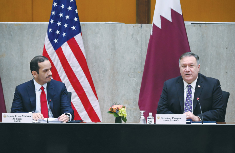 US SECRETARY of State Mike Pompeo welcomes Qatar's Deputy Prime Minister Mohammed bin Abdulrahman Al Thani to the third annual US-Qatar Strategic Dialogue in Washington on September 14.  (photo credit: REUTERS)