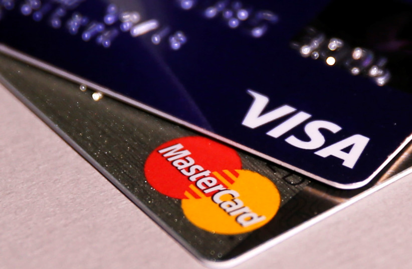 MasterCard and VISA credit cards are seen in this picture illustration taken June 9, 2016 (photo credit: MAXIM ZMEYEV/REUTERS)