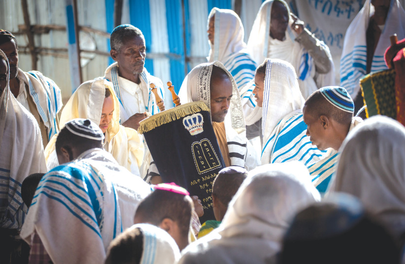 MEMBERS OF the Falash Mura community attend morning prayer services in the synagogue in Gondar, Ethiopia, in 2016.  (photo credit: MIRIAM ALSTER/FLASH90)