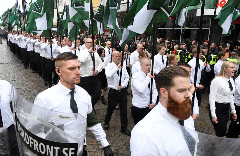 Members of the Neo-nazi Nordic Resistance Movement march through the town of Ludvika, 2018 (photo credit: ULF PALM/TT NEWS AGENCY/VIA REUTERS)