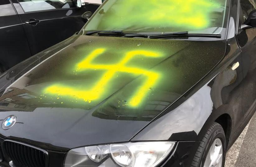 Swastika found painted on the hood of BMW in Bristol, England on Yom Kippur. (photo credit: WORLD ZIONIST ORGANIZATION)