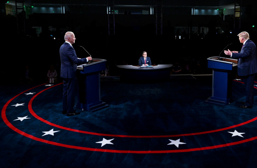U.S. President Donald Trump and Democratic presidential nominee Joe Biden participate in the first 2020 presidential campaign debate held on the campus of the Cleveland Clinic at Case Western Reserve University in Cleveland, Ohio, U.S., September 29, 2020 (photo credit: OLIVIER DOULIERY/POOL VIA REUTERS)